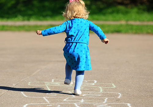Create a hopscotch course with colored tape on the floor, or draw the course on the sidewalk with colored chalk.