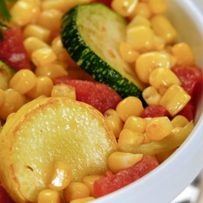 Summer squash pair with tomatoes and corn in this easy, flavorful side dish.